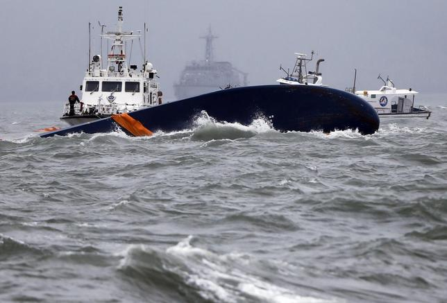 Vessels involved in salvage operations are seen near the upturned South Korean Sewol ferry in the sea off Jindo April 17, 2014 REUTERS/Issei Kato