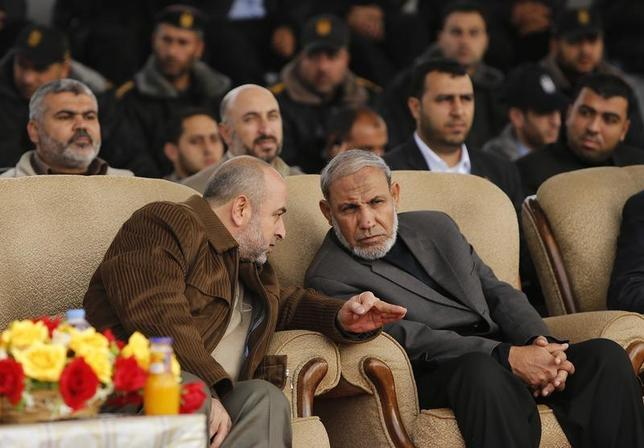 Head of Hamas security services Salah Abu Sharekh (L) speaks with senior Hamas leader Mahmoud Al-Zahar (R) during a graduation ceremony for members of Hamas security forces in Gaza City January 2, 2013. REUTERS/Suhaib Salem