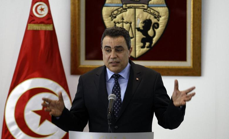 Tunisia's Prime Minister Mehdi Jomaa speaks during a news conference after his return from his visit to the United States at the Tunis-Carthage International Airport in Tunis April 6, 2014. REUTERS/Zoubeir Souissi