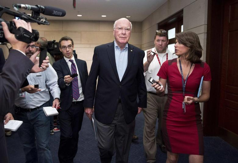 Senator Patrick Leahy (D-VT) (C) speaks to the media after attending a closed meeting for members of Congress on the situation in Syria at the U.S. Capitol in Washington September 1, 2013. REUTERS/Joshua Roberts
