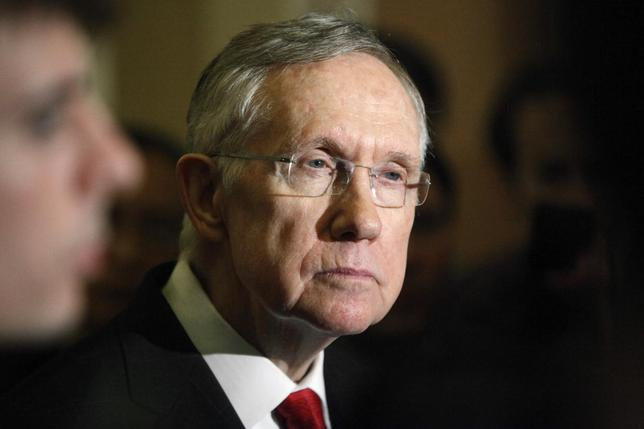 U.S. Senate Majority Leader Harry Reid (D-NV) answers questions from reporters after the weekly Republican caucus luncheon at the U.S. Capitol in Washington March 11, 2014. REUTERS/Jonathan Ernst