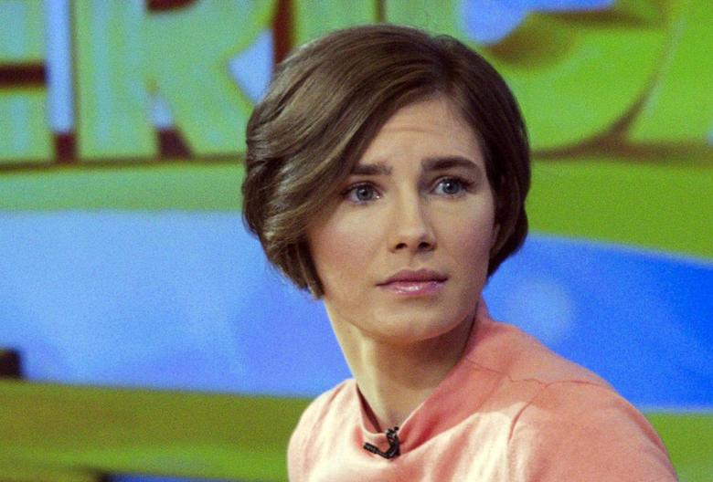 Amanda Knox reacts while being interviewed on the set of ABC's ''Good Morning America'' in New York January 31, 2014. REUTERS/Andrew Kelly