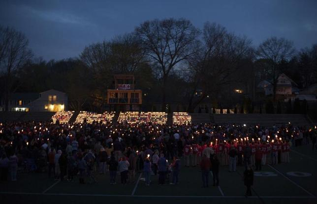 People gather at Jonathan Law High School during a vigil for slain student Maren Sanchez in Milford, Connecticut April 28, 2014. REUTERS/Michelle McLoughlin