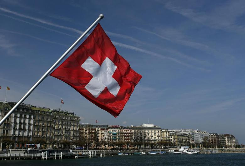 A Swiss flag is pictured on the Mont-Blanc bridge over Lake Leman in Geneva March 21, 2014. REUTERS/Denis Balibouse
