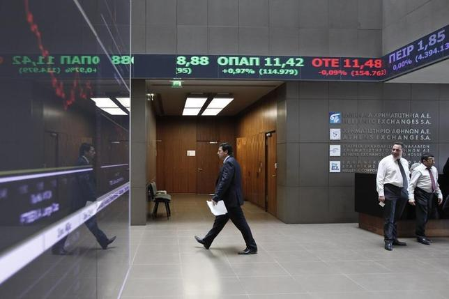 A man makes his way inside the reception hall of the Greek Stock Exchange in Athens April 10, 2014. REUTERS/Alkis Konstantinidis