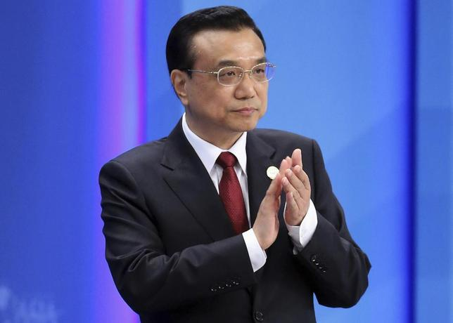 Chinese Premier Li Keqiang claps as he attends the opening ceremony of the Boao Forum for Asia (BFA) Annual Conference 2014 in Boao, Hainan province April 10, 2014. REUTERS/China Daily