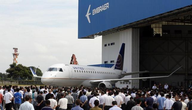 Brazilian aircraft manufacturer Embraer unveils its new regional jet E-175, in Sao Jose dos Campos, north of Sao Paulo March 12, 2014. REUTERS/Paulo Whitaker