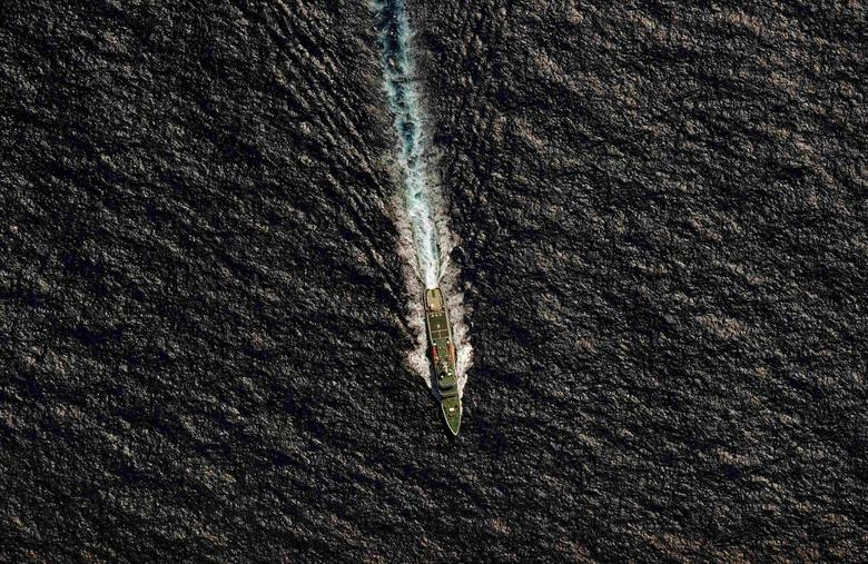 The Chinese Maritime Safety Administration (MSA) vessel Hai Xin 01 is seen from a Royal New Zealand Air Force (RNZAF) P-3K2 Orion aircraft in the southern Indian Ocean, as the search continues for missing Malaysia Airlines flight MH370 in this April 13, 2014 file photo. REUTERS/Greg Wood/Pool/Files