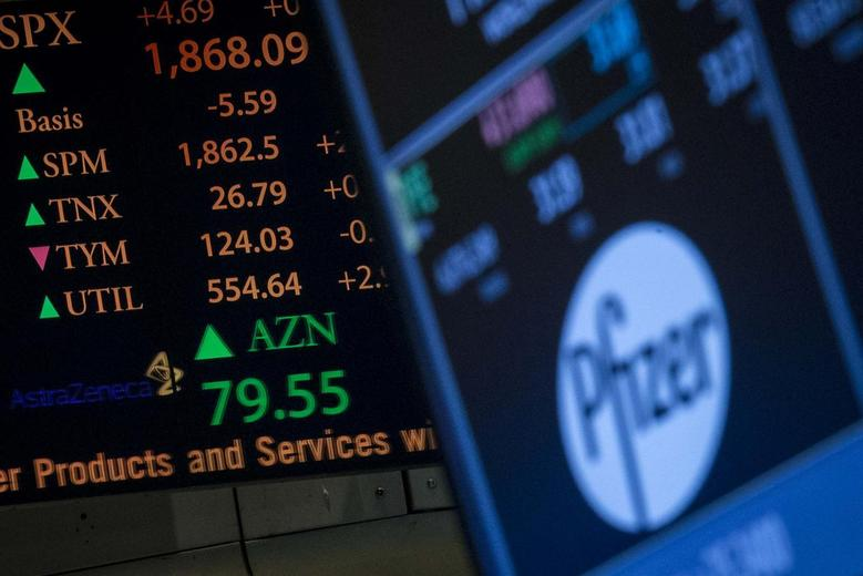 The ticker symbol for AstraZeneca is displayed next to a ticker for Pfizer on the floor of the New York Stock Exchange April 28, 2014. REUTERS/Brendan McDermid
