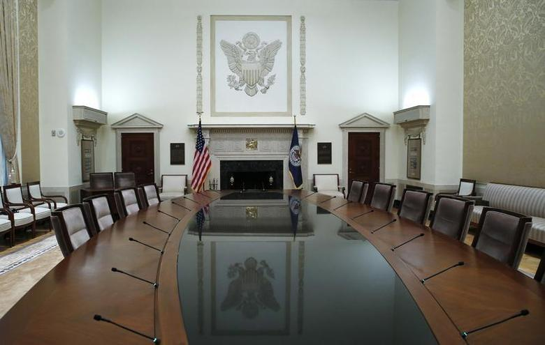 The conference table of the Federal Reserve Board of Governor is seen empty at Federal Reserve Board headquarters before new Chairwoman Janet Yellen took the oath of office in the conference room at the Federal Reserve Board in Washington, February 3, 2014. REUTERS/Jim Bourg