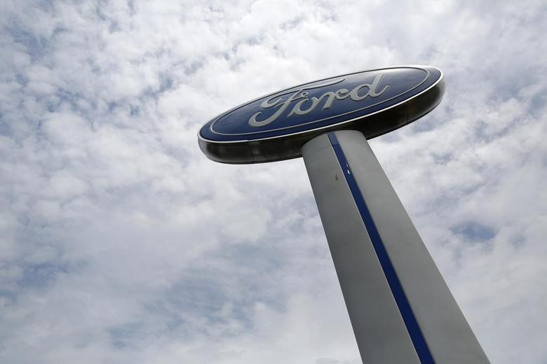 A Ford sign marks the lot at Koons Ford dealership in Fairfax, Virginia, July 24, 2013. REUTERS/Jonathan Ernst