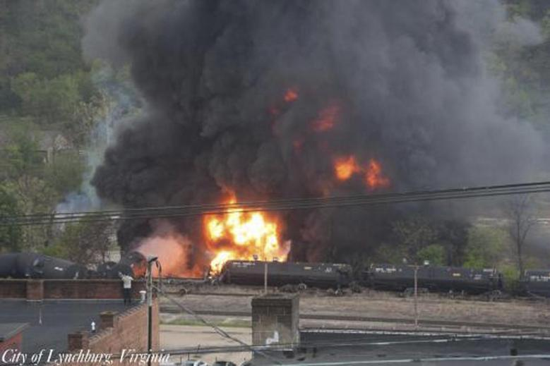 Flames and a large plume of black smoke are shown after a train derailment in this handout photo provided by the City of Lynchburg, Virginia April 30, 2014. REUTERS/City of Lynchburg, Virginia/Handout via Reuters