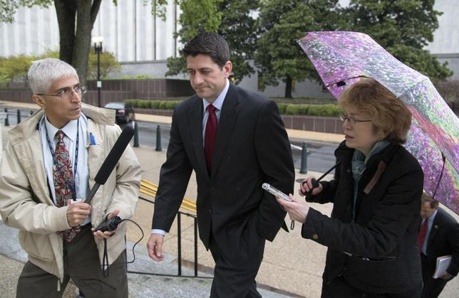 Representative Paul Ryan (R-WI) (C) talks to reporters as he departs a Republican House caucus meeting on Capitol Hill in Washington April 29, 2014. REUTERS/Jonathan Ernst