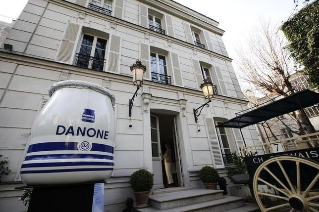A general view with a giant jar of yogurt is seen outside the exhibition to mark the 90th anniversary of the French foods company Danone, in Paris April 2, 2009. REUTERS/Jacky Naegelen