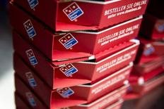 Delivery boxes for take-away pizzas are stacked at a Domino's Pizza store in Berlin, August 19, 2013. REUTERS/Thomas Peter