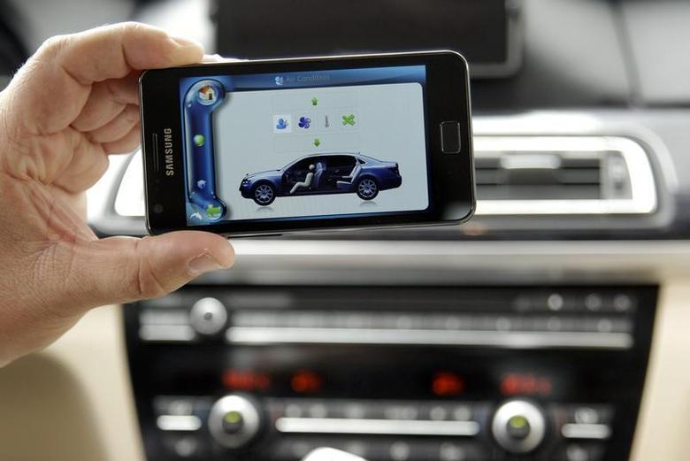 A man presents a Harman Car Connectivity System controlled with a smartphone during the opening day of the IFA consumer electronics fair in Berlin, August 31, 2012. REUTERS/Tobias Schwarz