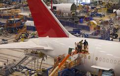 Workers at South Carolina Boeing construct a 787 Dreamliner for Air India at the plant's final assembly building in North Charleston, South Carolina December 19, 2013. REUTERS/Randall Hill