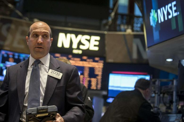 Traders work on the floor of the New York Stock Exchange April 30, 2014. REUTERS/Brendan McDermid