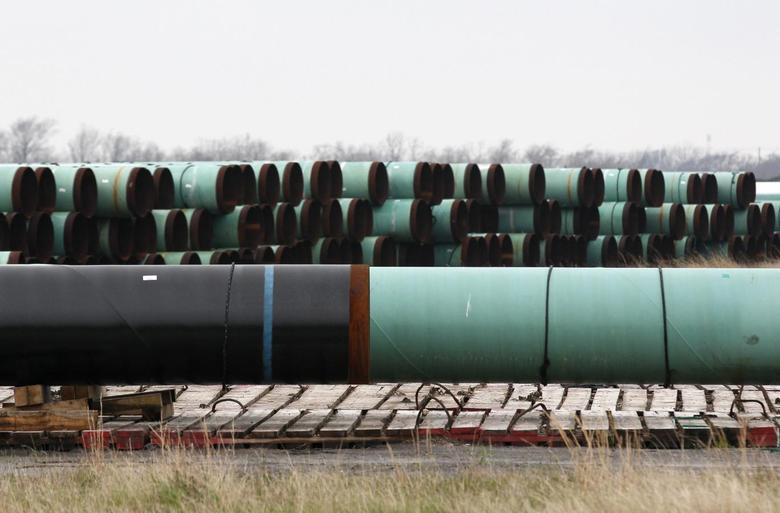 Stacks of pipe are stored at the pipe yard for the Houston Lateral Project, a component of the Keystone pipeline system in Houston, Texas March 5, 2014. REUTERS/Rick Wilking