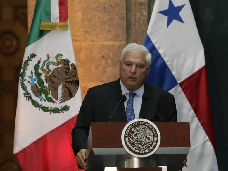 Panama's President Ricardo Martinelli gives a speech to the media, next to Mexico's President Enrique Pena Nieto (not pictured), during an official welcoming ceremony for Martinelli, at the National Palace in Mexico City March 24, 2014. REUTERS/Henry Romero