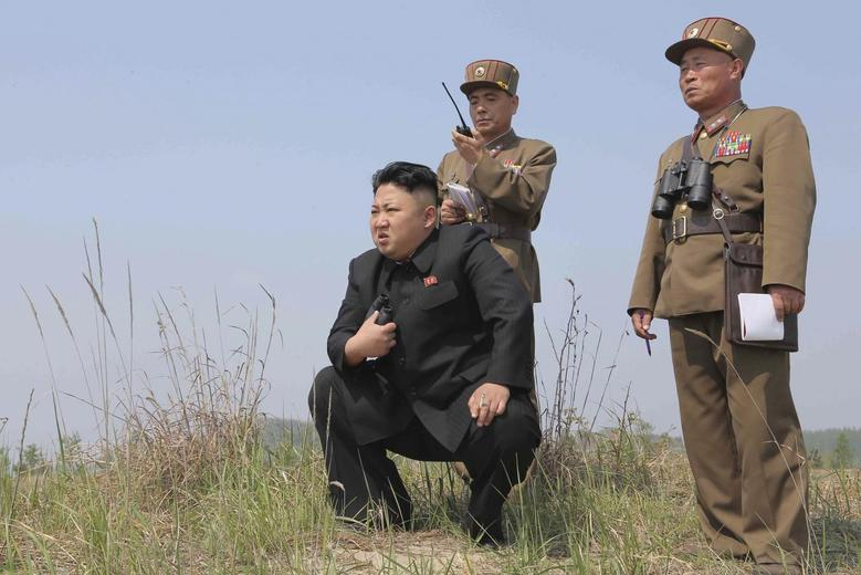 North Korean leader Kim Jong Un (C) guides the multiple-rocket launching drill of women's sub-units under KPA Unit 851, in this undated photo released by North Korea's Korean Central News Agency (KCNA) April 24, 2014. REUTERS/KCNA