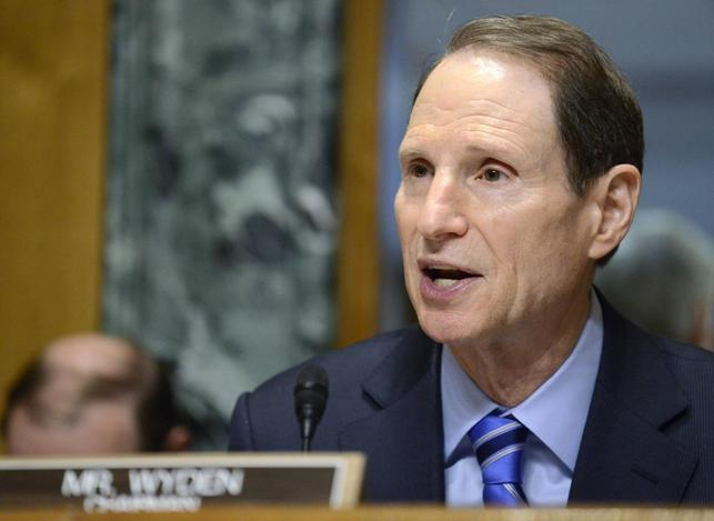 Senate Finance Committee Chairman Ron Wyden (D-OR), who is attending his first hearing as chairman after the retirement of Sen. Max Baucus (D-MT) makes opening remarks as on hearings on President Obama's Fiscal Year 2015 Budget, on Capitol Hill, in Washington, March 5, 2014. REUTERS/Mike Theiler