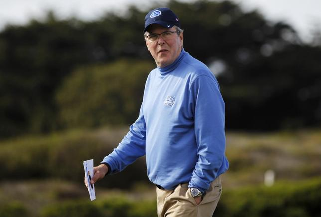 Former Florida Governor Jeb Bush walks on the 13th hole during the first round of the Pebble Beach National Pro-Am golf tournament on the Monterey Peninsula Country Club course in Pebble Beach, in California, February 6, 2014. REUTERS/Michael Fiala
