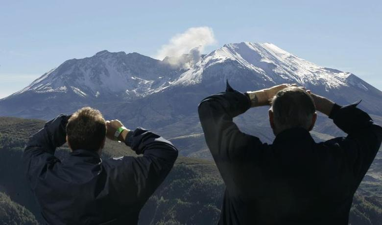 Visitors to the Coldwater Ridge Center look up at Mount St. Helens venting steam October 11, 2004. REUTERS/Andy Clark