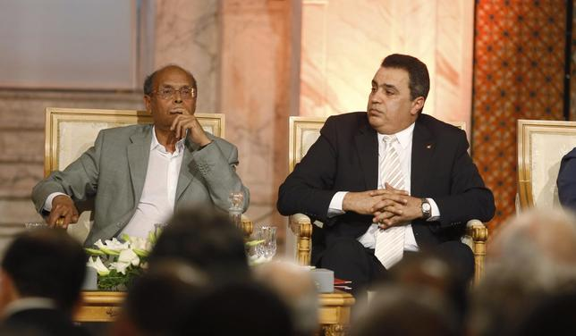 Tunisia's President Moncef Marzouki (L) and Prime Minister Mehdi Jomaa listen during a meeting to celebrate International Workers' Day, or Labour Day, in Tunis, May 1, 2014. REUTERS/Zoubeir Souissi