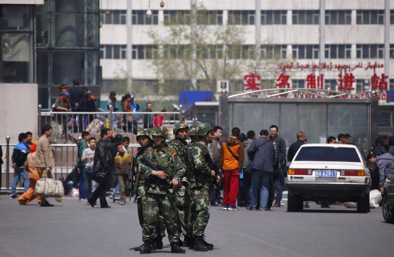 Paramilitary policemen stand guard near the exit of the South Railway Station, where three people were killed and 79 wounded in a bomb and knife attack on Wednesday, in Urumqi, Xinjiang Uighur Autonomous region, May 1, 2014. REUTERS/Petar Kujundzic