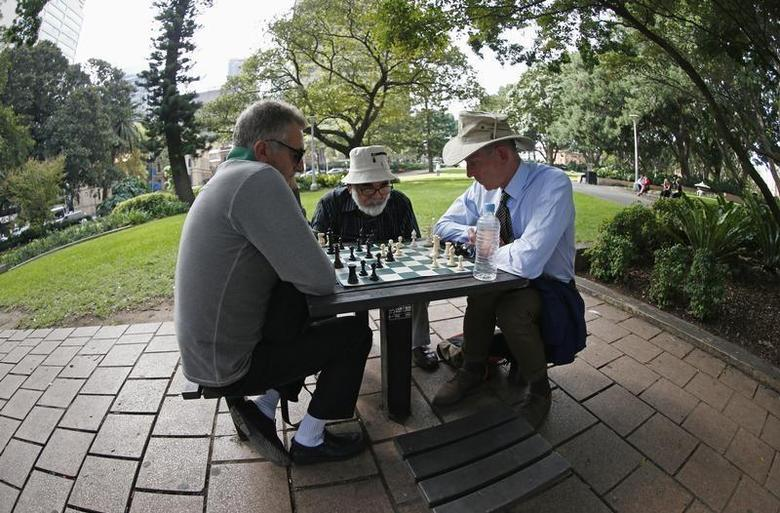 Men play chess at Hyde Park in central Sydney April 15, 2013. REUTERS/Daniel Munoz