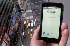A posed picture shows a phone displaying the Google search page in New York August 15, 2011. REUTERS/Brendan McDermid