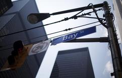A Bay Street sign is seen in the heart of the financial district in Toronto, August 17, 2009. Toronto's main stock market index dove on Monday morning as commodity-linked stocks sank with oil and metals prices on worries over the pace of economic recovery. REUTERS/Mark Blinch