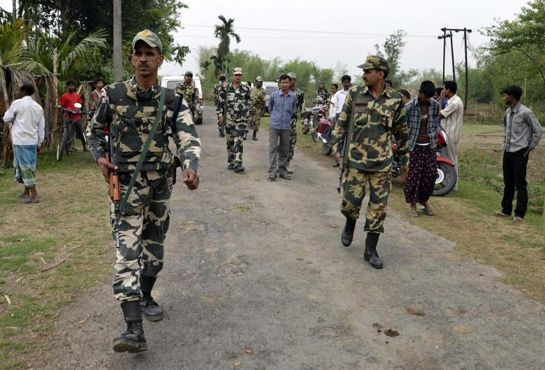 Indian security personnel patrol the attack-hit area of the Balapara village in the northeastern Indian state of Assam May 2, 2014. REUTERS/Stringer