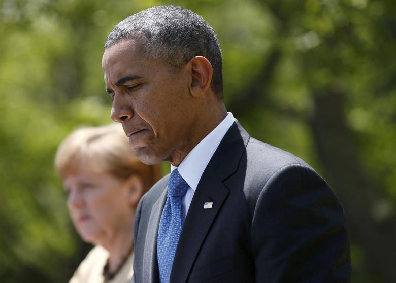 U.S. President Barack Obama pauses during a joint news conference with German Chancellor Angela Merkel in the Rose Garden of the White House in Washington May 2, 2014. REUTERS/Kevin Lamarque