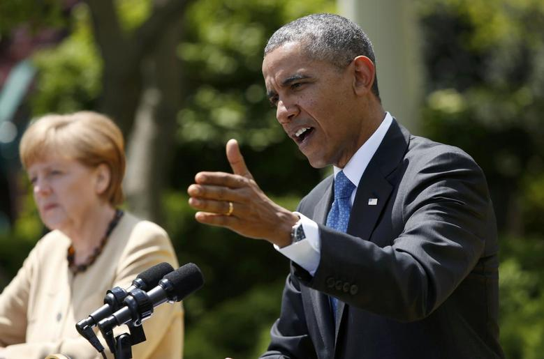 U.S. President Barack Obama and German Chancellor Angela Merkel address a joint news conference in the Rose Garden of the White House in Washington May 2, 2014. REUTERS/Kevin Lamarque