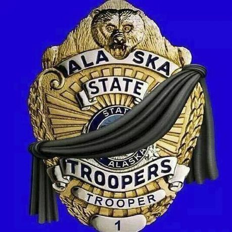 An illustration showing a black band across an officer's shield appears on the official Facebook page of the Alaska State Troopers in Anchorage May 2, 2014. REUTERS/Alaska State Troopers/Handout via Reuters