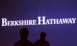 Berkshire Hathaway shareholders walk by a video screen at the company's annual meeting in Omaha in this May 4, 2013 file photo. REUTERS/Rick Wilking/Files