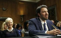 Actor, writer and director Ben Affleck (R) testifies before the Senate Foreign Relations Committee on Capitol Hill in Washington February 26, 2014.  REUTERS/Gary Cameron