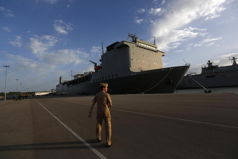 A U.S. navy personnel walks near the U.S. MV Cape Ray ship docked at the naval airbase in Rota, near Cadiz, southern Spain April 10, 2014. REUTERS/Marcelo del Pozo