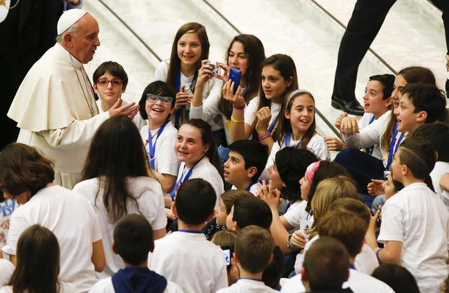 Pope Francis talks with children during a special audience with members of the ''Catholic Action'' in Paul VI hall at the Vatican May 3, 2014. REUTERS/Tony Gentile