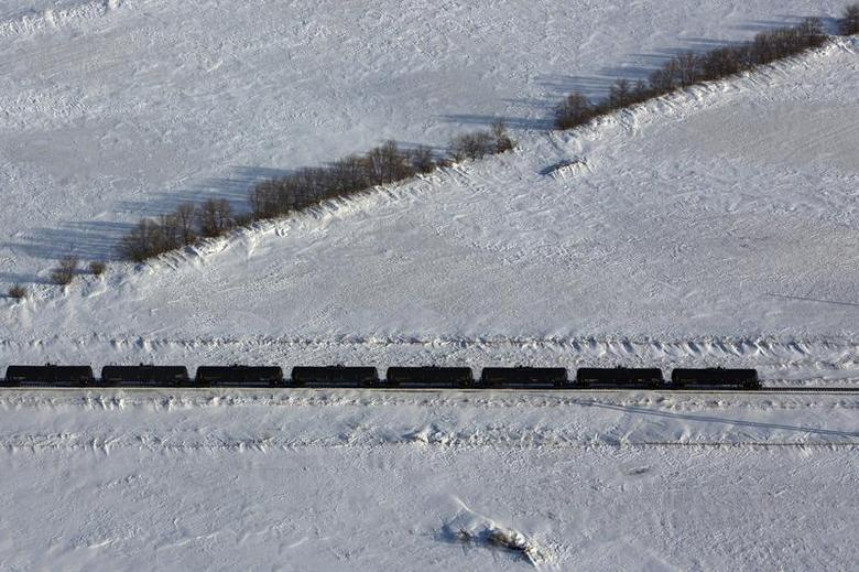 An aerial view shows a train making its way along the Burlington Northern Santa Fe (BNSF) rail line outside of Williston, North Dakota March 12, 2013. REUTERS/Shannon Stapleton
