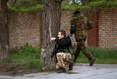 Dozens killed in Ukraine fighting and fire; OSCE...