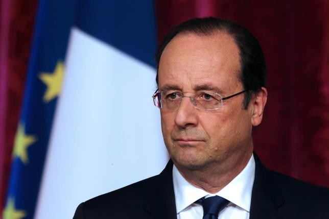 French President Francois Hollande pauses as he attends a news conference at the Elysee Palace in Paris, April 29, 2014. REUTERS/Philippe Wojazer
