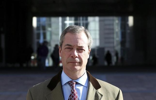 Britain's UK Independence Party (UKIP) leader and member of the European Parliament (MEP) Nigel Farage walks outside the EU Parliament ahead of an interview with Reuters in Brussels February 12, 2014. REUTERS/Francois Lenoir