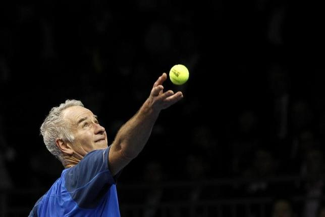 John McEnroe of the U.S. serves the ball to compatriot Ivan Lendl during their BNP Paribas Showdown tennis friendly match in Hong Kong March 4, 2013. REUTERS/Tyrone Siu