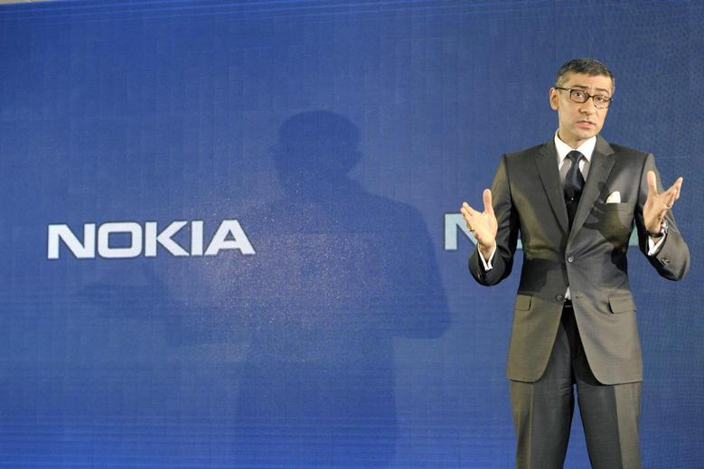Nokia CEO Rajeev Suri speaks during a news conference to announce its first quarter earnings in Espoo April 29, 2014. REUTERS/Heikki Saukkomaa/Lehtikuva