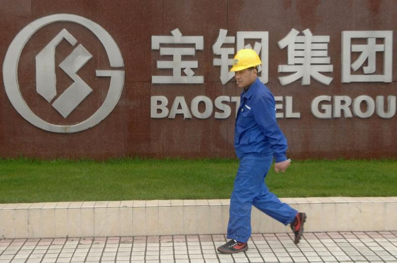 A labourer walks past the gate of the headquarters of Baosteel Group Corp. in Shanghai, in this April 1, 2010 file photo. REUTERS/Stringer/Files