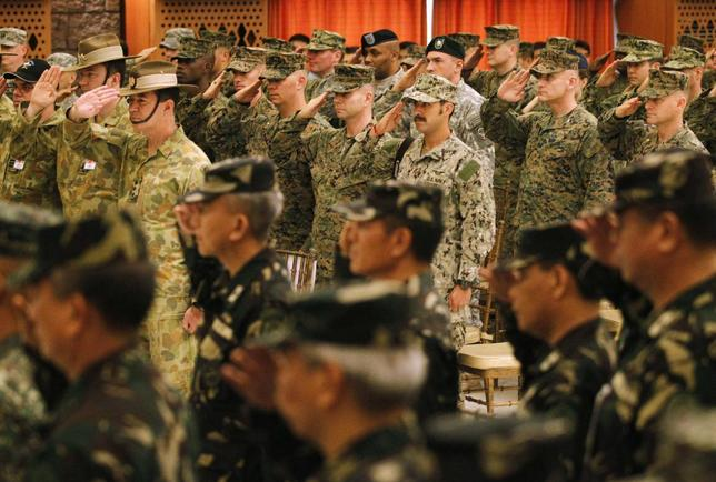 U.S. and Filipino military officers salute during the opening ceremony of the Balikatan 2014 Joint Exercise inside the Armed Forces of the Philippines (AFP) headquarters at Camp Aguinaldo in Quezon city, metro Manila May 5, 2014. REUTERS/Romeo Ranoco