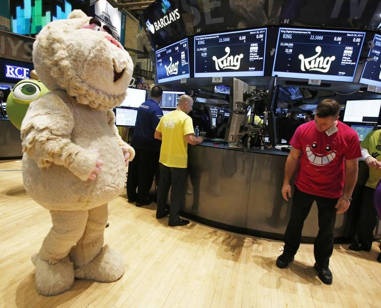 A mascot dressed as a character from the mobile game ''Candy Crush Saga'' walks the floor of the New York Stock Exchange during the IPO of Mobile game maker King Digital Entertainment Plc March 26, 2014. REUTERS/Brendan McDermid